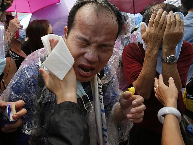 Terrifying scenes ... Hong Kong police have use tear gas to clear thousands of pro-democr