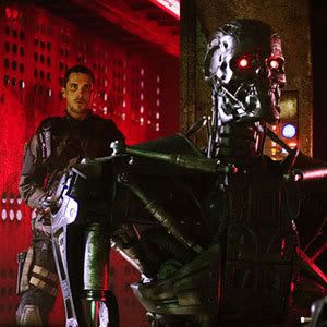 John Connor (Christian Bale) sneaks up on a cyborg in TERMINATOR SALVATION...out in theaters on May 22.