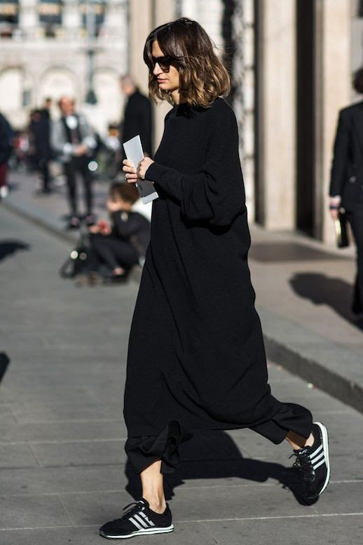 Le Fashion Blog Fall Style All Black Look Sunglasses Long Sweaterdress Cropped Wide Leg Pants Sneakers Via Sandra Semburg