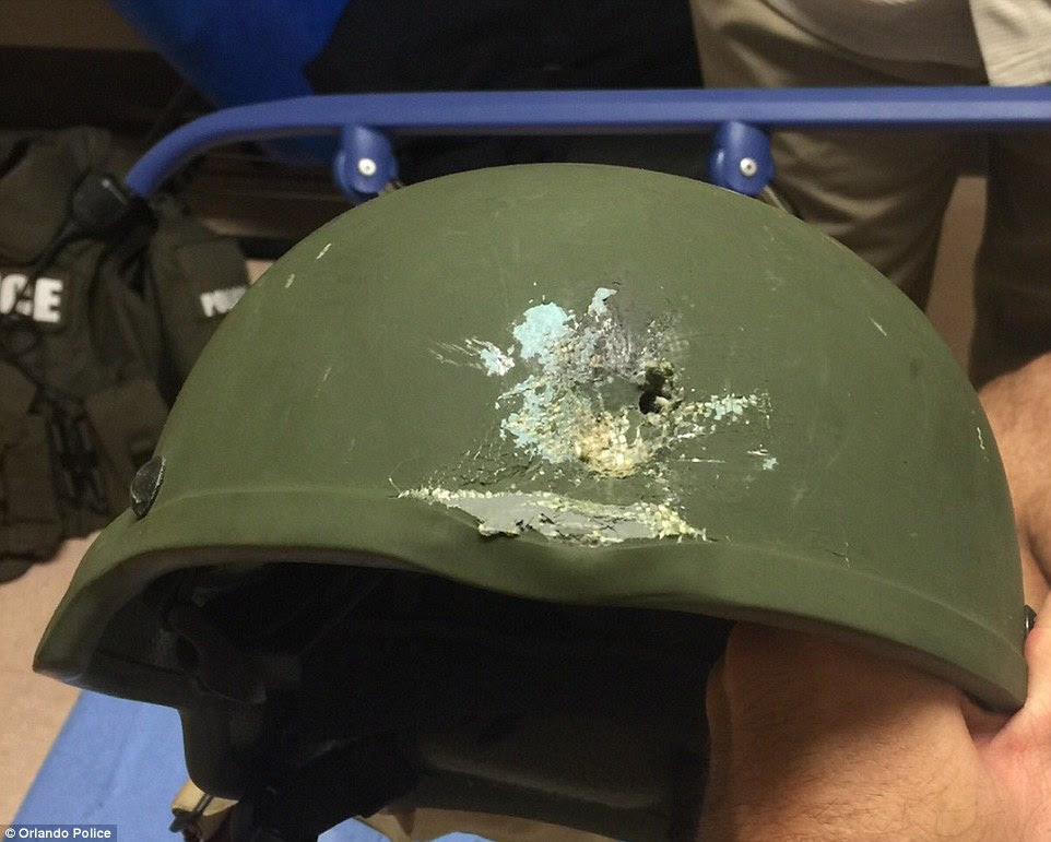 Nine hero officers used a 'controlled explosion' to distract the shooter before fatally shooting him and were able to rescue about 30 hostages who were hiding in the bathroom of the club. During the gunfire, an officer was shot, but he was saved by his helmet (pictured)