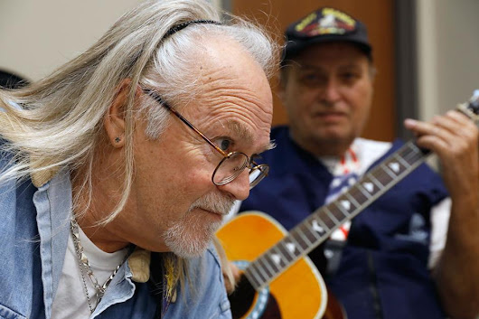 Veterans experience the healing power of music through guitar lessons