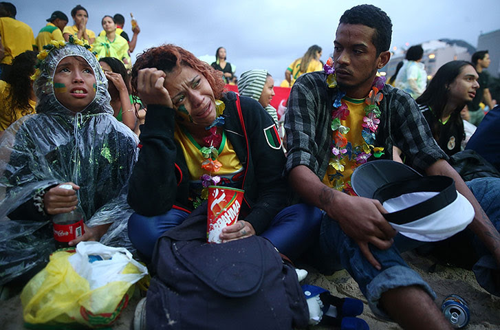 Brazilians in shock-: Brazilian Fans Cheer On Their National Team During World Cup Semi Finals