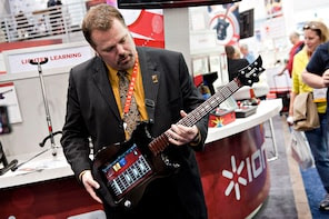 An ION Guitar Apprentice iPad accessory is demonstrated during the 2012 International Consumer Electronics Show (CES) in Las Vegas, Nevada, U.S., on Wednesday, Jan. 11, 2012. The 2012 CES trade show features 2,700 global technology companies presenting consumer tech products and is expected to draw over 140,000 attendees. Photographer: Daniel Acker/Bloomberg