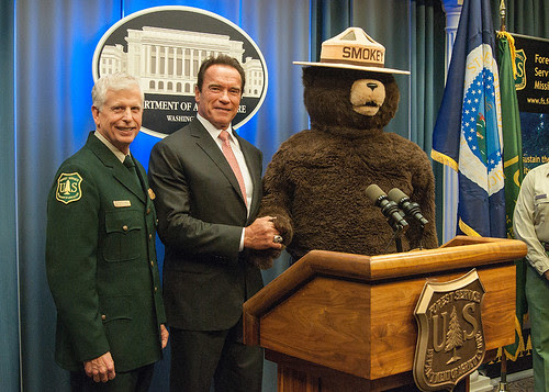 (left to right) Chief Tom Tidwell, former Governor Arnold Schwarzenegger and Smokey Bear at today's ceremony. (Photo by Bob Nichols, USDA)