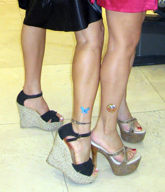 Ling and a client model their Swarovski jewelled tattoos at her Salon