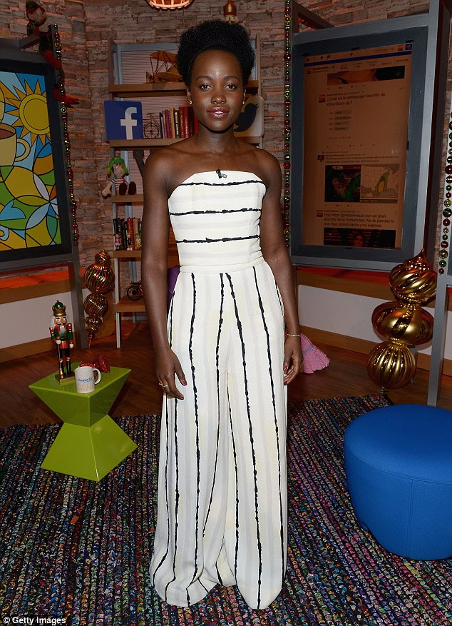 Elegant: Lupita has been stunning at all the events surrounding the film's December 18 U.S. release and carried on that theme here too