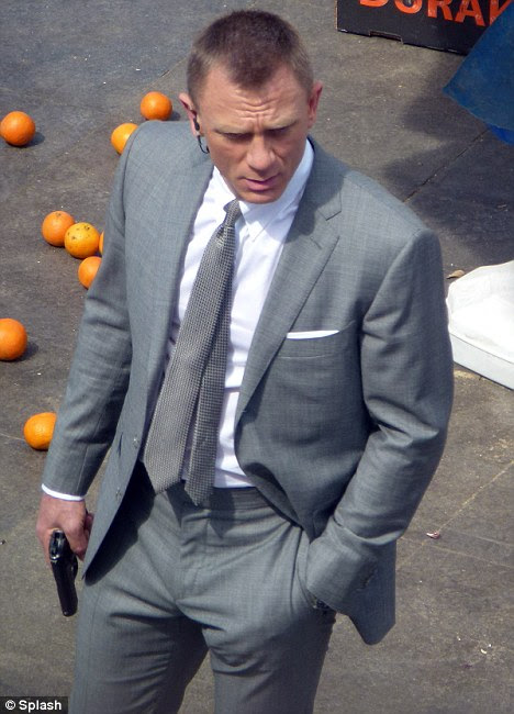 Chaos: Daniel Craig looks dapper in his suit as he films Bond movie Skyfall in Istanbul, Turkey