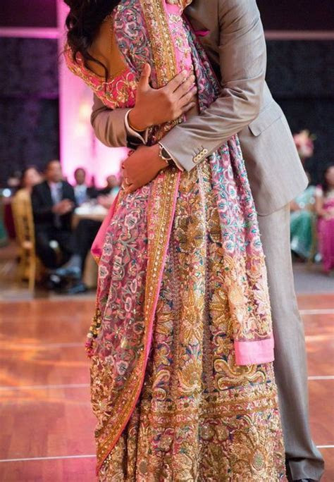 Gorgeous colourful lehenga and a tight embrace, Indian