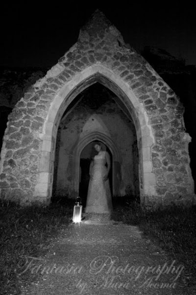 Waiting at the Church (Black and White) - Art Photographic Print showing a ghost by her grave.