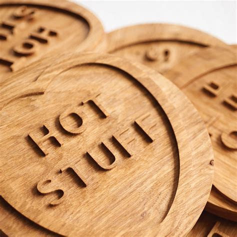 solid oak 'hot stuff' trivet by wood paper scissors