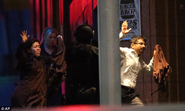 Given up control: At Woolwich, in Ottawa and now in Sydney, deranged maniacs kill, in most cases while out of their minds on the drugs. Above, hostages escape from the Sydney cafe targeted by extremists last week