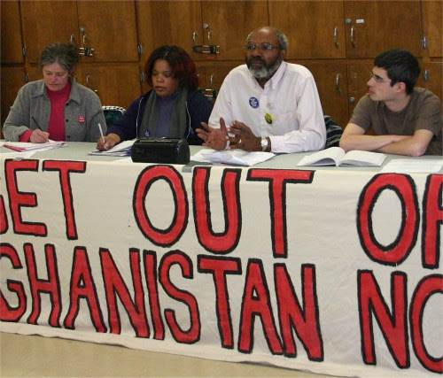 Abayomi Azikiwe, PANW editor, second from left, at anti-war forum in Windsor, Canada on March 17, 2007. He was joined by Andrea Egypt of MECAWI on his right, Margaret on far right and Enver on left of the Windsor Peace Coalition. by Pan-African News Wire File Photos