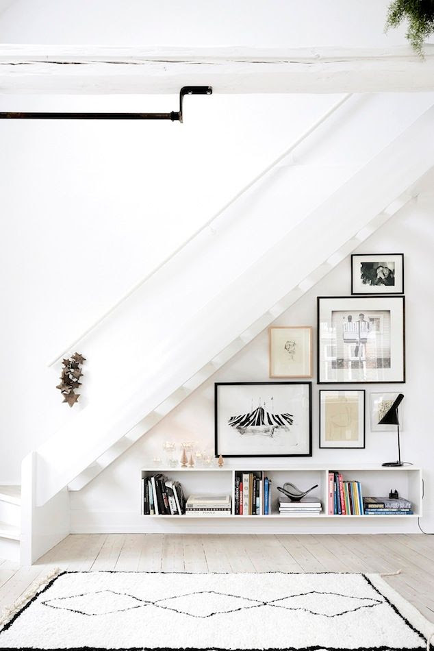Le Fashion Blog Minimal Scandinavian Interior Design Decor Ideas Under The Stairs Staircase Floating Shelves Clean Black Table Lamp Shaggy Moroccan Rug White Wash Wood Floors Via Pia Winther