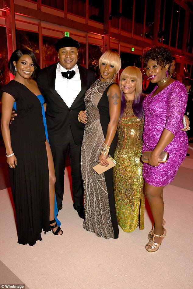 Dazzling: Gabrielle was rubbing shoulders with the stars as she joined LL Cool J, singer Mary J. Blige, Simone Smith and a fellow reveller (left-right)