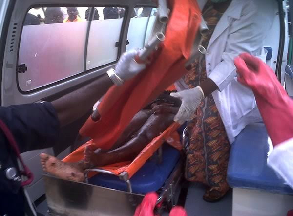 This image released by Saharareporters shows an injured person in an ambulance after a large explosion struck the United Nations' main office in Nigeria's capital Abuja Friday Aug. 26, 2011, flattenin