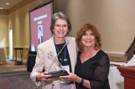 Susan Bennett poses with Consortium of MS Centers CEO June Halper after receiving the organization's Lifetime Achievement Award in June.