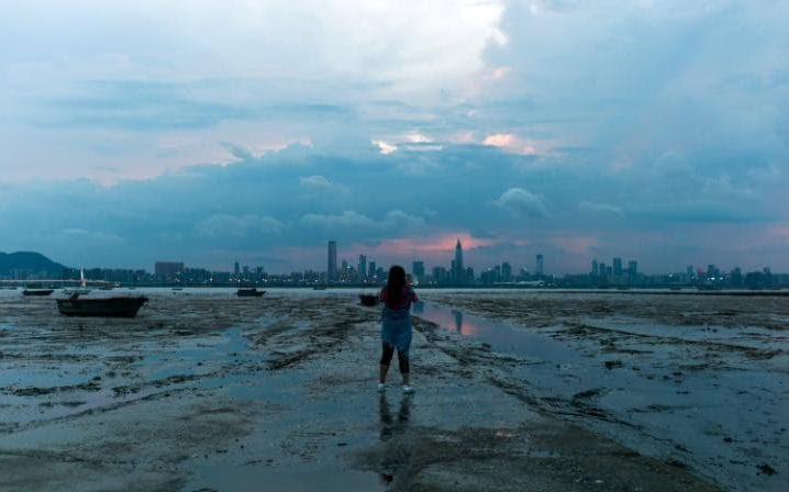 A woman looks at the city of Shenzhen