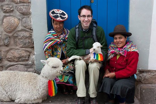 Jon with an alpaca and lamb