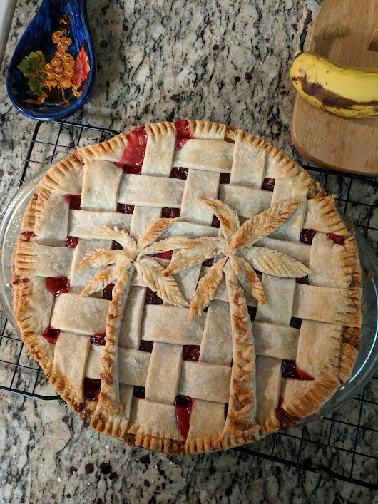 Cherry pie with a palm tree design