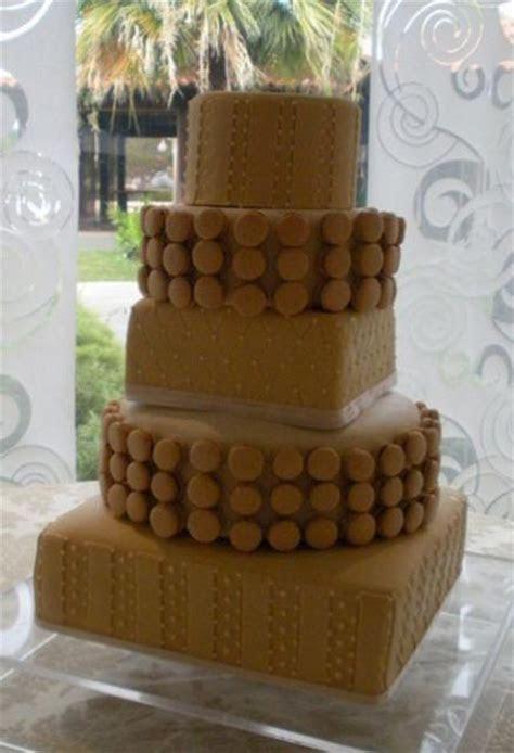 4 tier chocolate theme square and round wedding cake