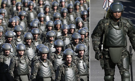 Brazil's Robocops march in full body armour ahead of World Cup