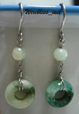 A pair of Wire Wrap Jade Earring