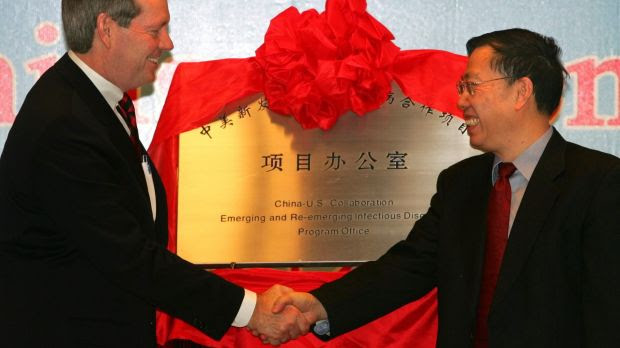 Then Chinese vice-minister of health, Huang Jiefu, right, during the opening of a Sino-US collaborative office at the Chinese Centre for Disease Control in 2006.