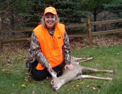 "Wisconsin DNR Secretary Cathy Stepp proudly shows off her first deer, taken opening weekend last year. In the upcoming TV Special ""Deer Hunt Wisconsin 2012, Stepp urges male hunters to take more girls and women hunting. ""The secret's out,"" she says. ""Hunting is a lot of fun, so don't keep it to yourselves.""  photo courtesy of Wisconsin DNR"
