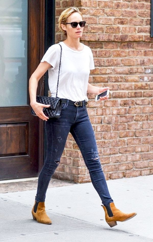 Le Fashion Blog Model Off Duty Street Style Amber Valletta White Tee Quilted Bag Leather Belt Dark Ripped Jeans Tan Saint Laurent Suede Boots Via Zimbio