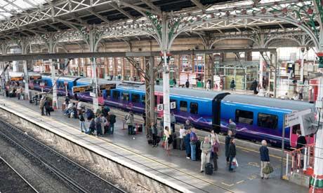 local commuter diesel train by the platform Preston railway station, Lancashire England UK