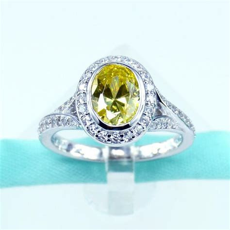 Oval Cut Yellow CZ Womens Engagement Ring in Sterling