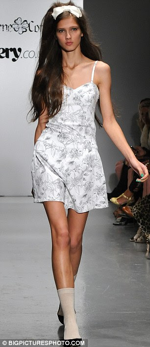Fun and flirty: A white patterned dress and a tight black and white outfit also walked the runway
