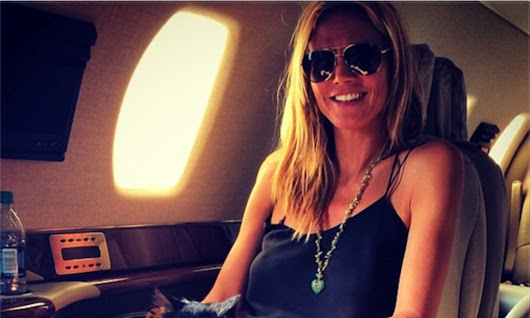 Heidi Klum shows off feline friend on her private jet after Texas trip