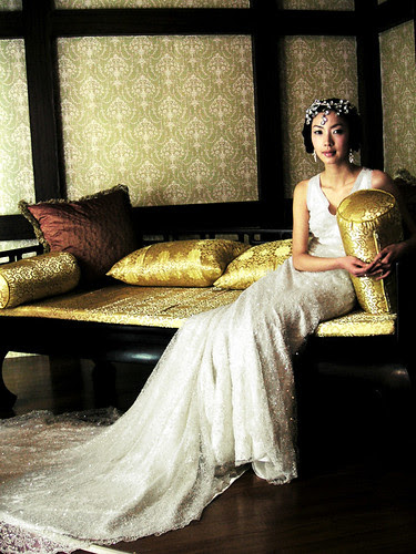 royal-style wedding gown of white china knick-knacks covered stone