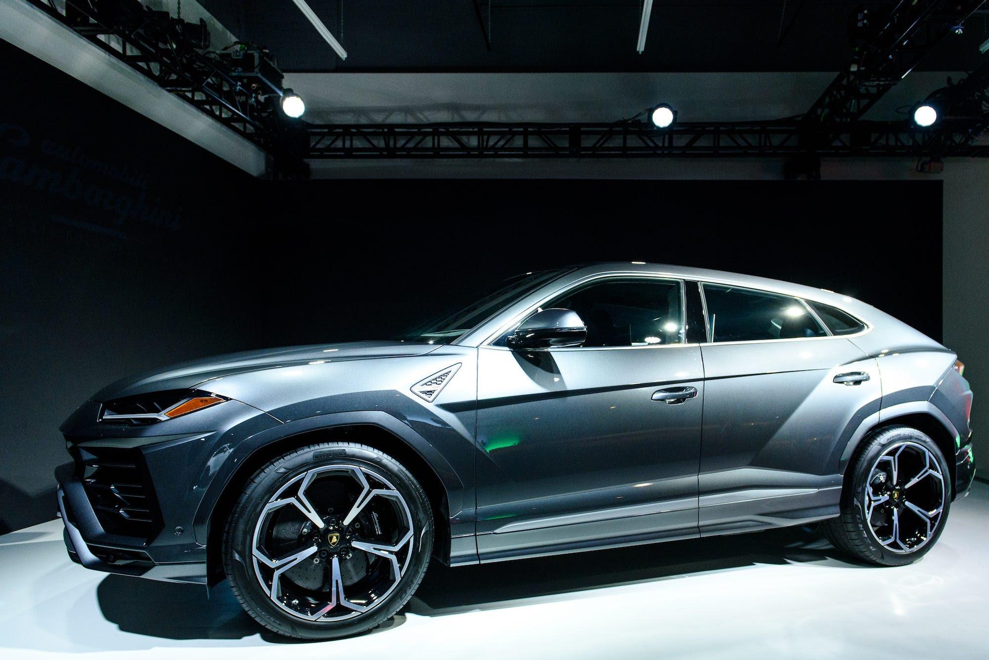 Lamborghini Urus designer drawing with tape  Business Insider