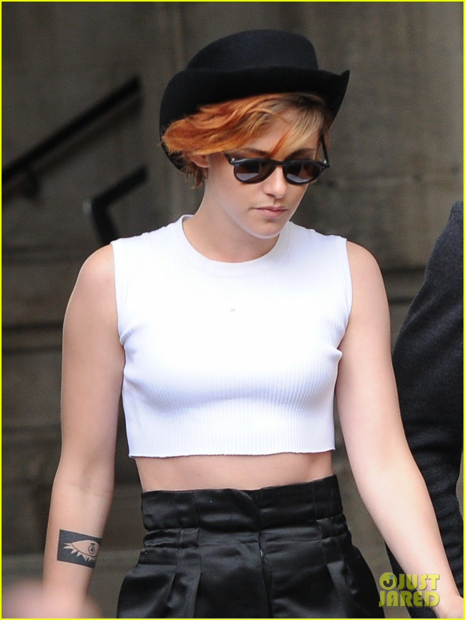 kristen stewart covers up her new short hair with a hat 09