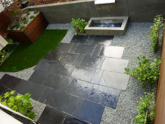 Custom Waterfall and Limestone Patio