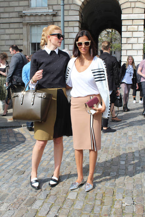 Eva (left) wears: Bag: Aspinal, Shades: Celine, Top: H&M, Skirt: Zara, Shoes: Dune. Atosa (right) wears: Jacket: Pretty Little Thing, Bag: Zara, Skirt: Zara, Shoes: Zara, Shades: Topshop