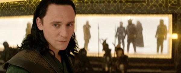 Loki (Tom Hiddleston) is amused as Asgard falls under attack in THOR: THE DARK WORLD.