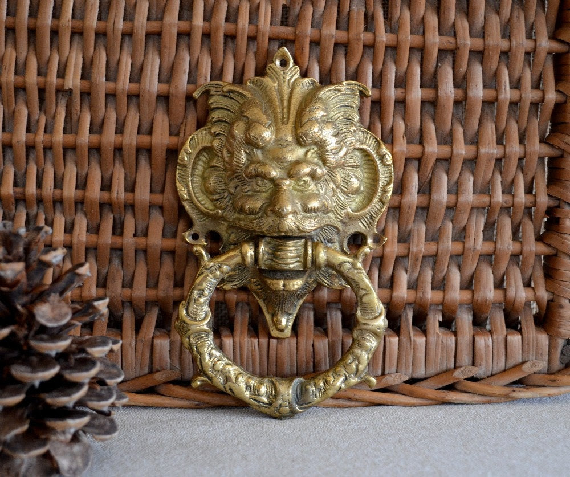 vintage English brass devil or mythical door knocker