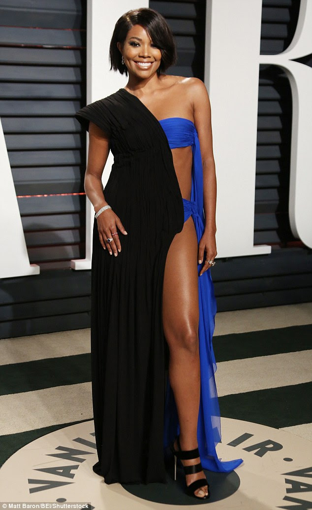 Peek-a-boo! The Gaultier gown revealed the 44-year-old star's flat abs and long legs on its daring blue half