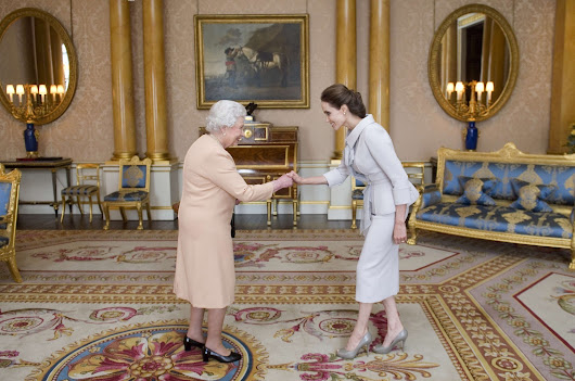 Angelina Jolie, now an honorary dame, meets with Queen Elizabeth II