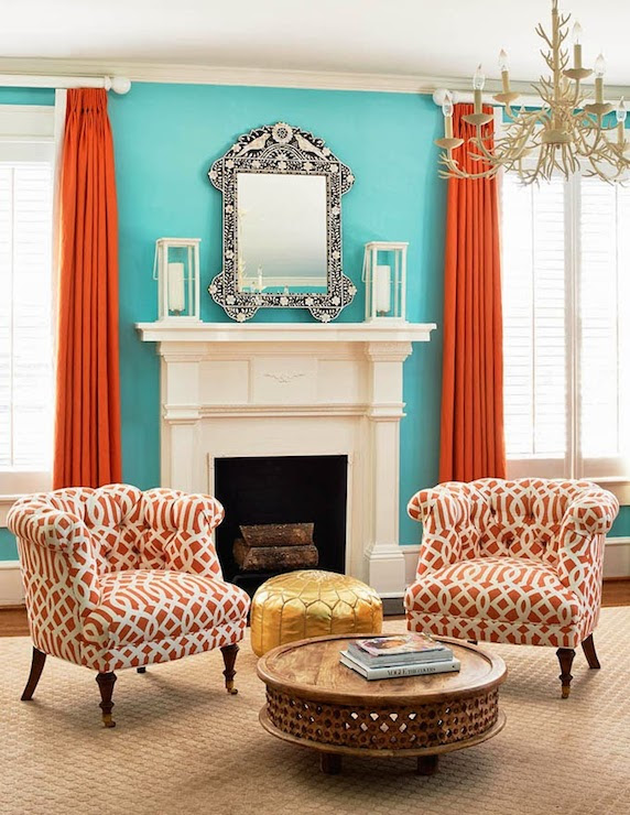 Holly Hollingsworth Phillips - living rooms - Carved Wood Coffee Table, blue and orange rooms, blue and orange living rooms, turquoise rooms, orange and turquoise rooms, orange and turquoise living rooms, orange curtains, orange drapes, bone inlay mirror, bone inlaid mirror, black and white mirror, fireplace mirrors, white lanterns, fireplace lanterns, white and orange chairs, trellis chairs, imperial trellis chairs, orange chairs, orange trellis chairs, carved wood coffee table, round coffee table, gold pouf, gold moroccan pouf, mother of pearl mirror, black and white mother of pearl mirror,