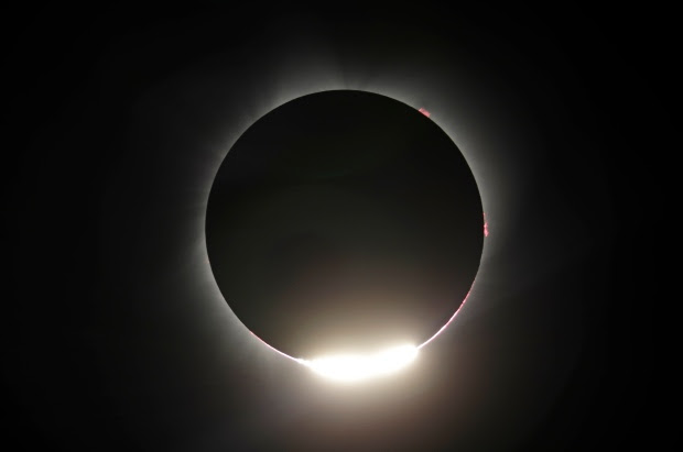 The sun is shown nearing a total eclipse by the moon, Monday, Aug. 21, 2017, near Redmond, Ore. (AP Photo/Ted S. Warren)