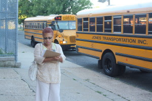 Antoinette Baskerville-Richardson, aschool board member, recrods data on empty buses on the first day of school