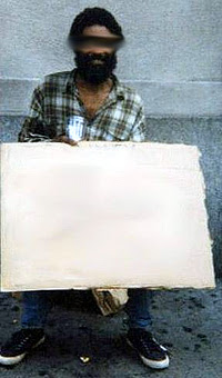 Cue card guy holds up blank poster card.