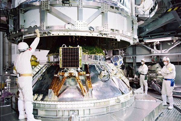 At the Tanegashima Space Center in Japan, JAXA's Hayabusa 2 spacecraft is about to be encapsulated by the payload fairing of its H-IIA launch vehicle...on November 17, 2014.
