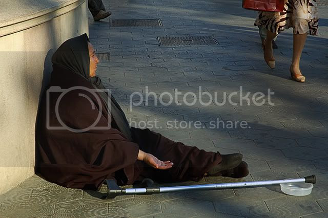Poverty-Stricken Barcelona: Woman Begging, Paseo de Gracia [enlarge]