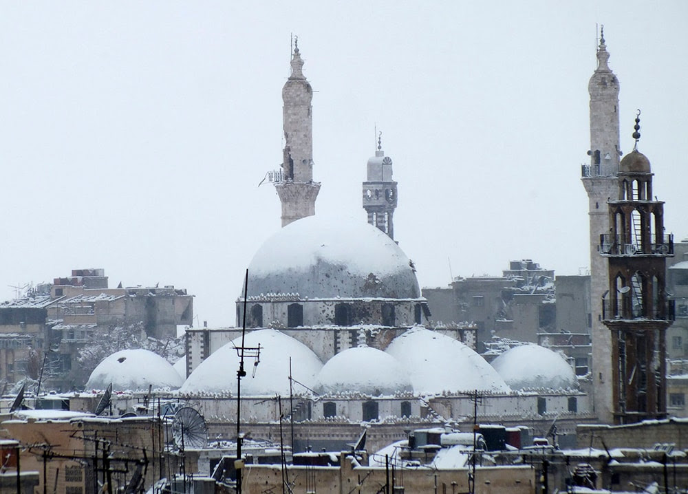 The Khalid bin al Walid Mosque, in the devastated city of Hom, covered with snow. (REUTERS/Yazan Homsy)