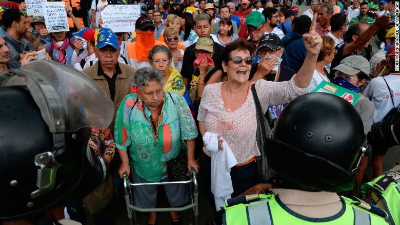 An elderly woman with a walker leads a group of desmonstrators during a grandparents' march on the streets of Venezuela's capital on Friday.